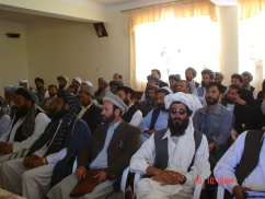 Candidate election brief in Wardak province.  This was one of only two buildings left standing in the provincial capital.