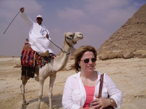 A popular trade at the pyramids - camel owners charges $20 to pose in shot. Photo bombing was the result if you declined.  A better picture I think!