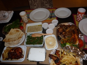 My favourite take out food was from an immensely popular restaurant called the Lebanese Flower.  Their spit roast chicken was to die for.  All this lot would cost approx 200 AED (£35 or $55) and feed at least four.