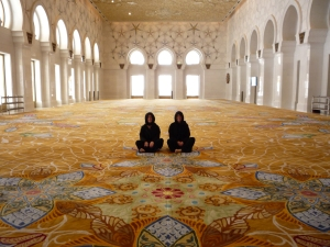 My friend Danielle and her sister Terry in the ladies prayer room at the Sheikh Zayed Mosque.  You need to get in the moment the mosque opens to get this shot - moments later it soon fills up with other visitors.